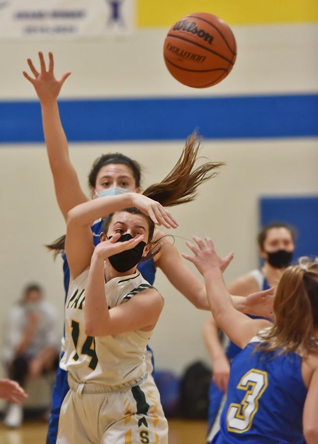 Stevenson's Ava Bardic passes out of the Lake Forest defense in a girls basketball game in Buffalo Grove Monday night.