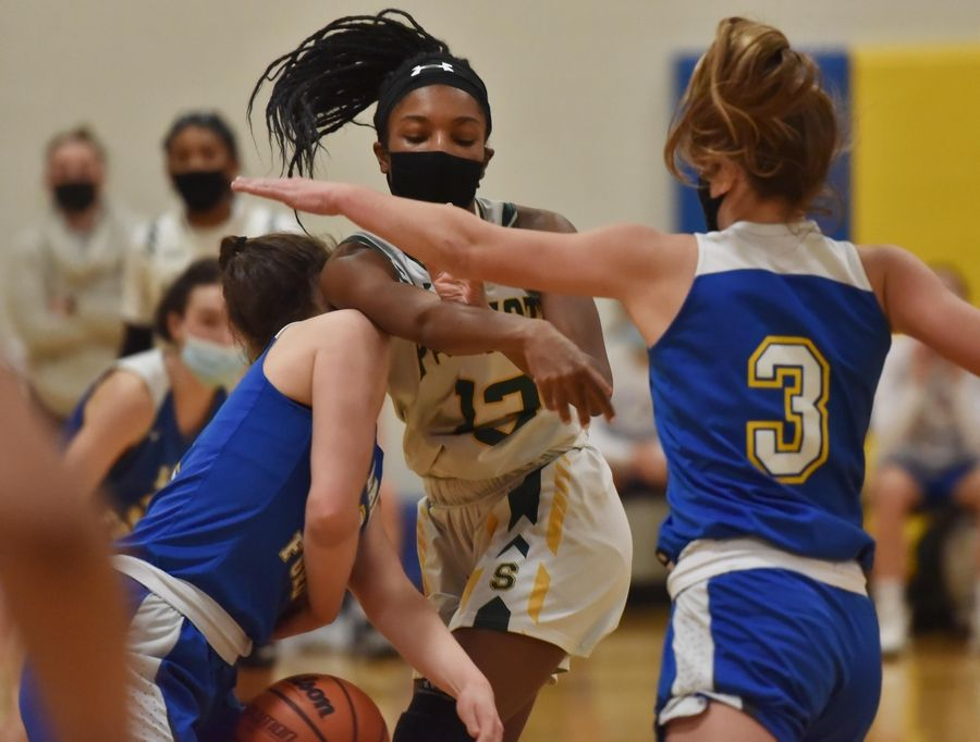 Stevenson's Simone Sawyer loses the ball against Lake Forest in a girls basketball game in Buffalo Grove Monday night, February 22, 2021.