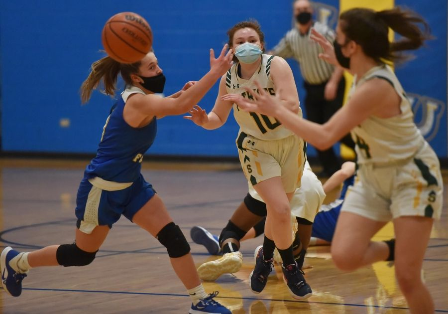 Stevenson's Nikki Ware passes the ball to teammate Ava Bardic against Lake Forest in a girls basketball game in Buffalo Grove Monday night, February 22, 2021.