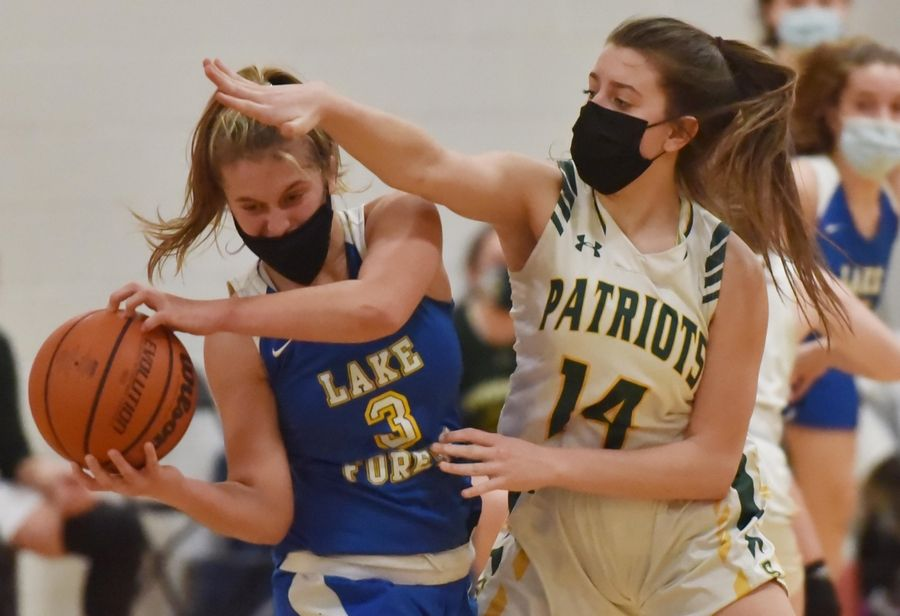 Stevenson's Ava Bardic guards Lake Forest's Bella Ranallo in a girls basketball game in Buffalo Grove Monday night, February 22, 2021.