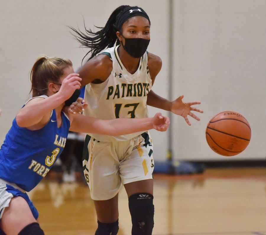 Lake Forest's Bella Ranallo strips the ball from Stevenson's Simone Sawyer in a girls basketball game in Buffalo Grove Monday night, February 22, 2021.