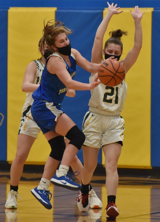 Stevenson's Lydia Lueck, right, and Ava Bardic force Lake Forest's Bella Ranallo to pass the ball out in a girls basketball game in Buffalo Grove Monday night, February 22, 2021.