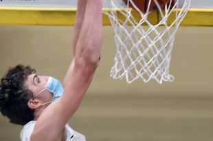 Glenbrook South's Nick Martinelli dunks during Saturday's game against New Trier.