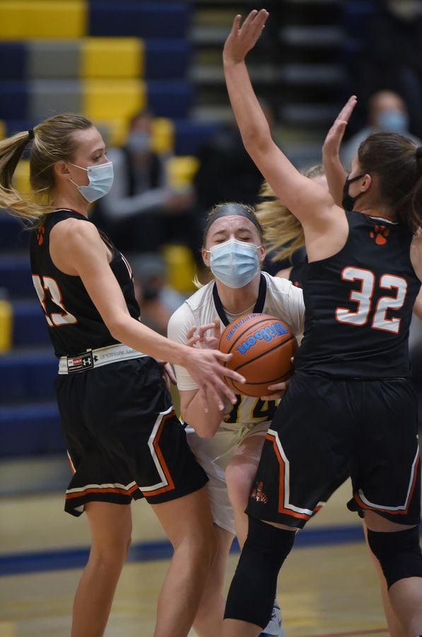 Glenbrook South's Tabitha Tibbetts tries to get through Libertyville's Morgan Spaulding and Rachel Rule, right, in a girls basketball game in Glenview Monday, March 1, 2021.