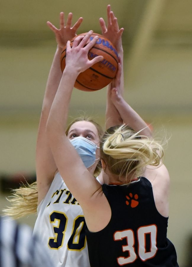 Libertyville's Kristina Kotzan pressures Glenbrook South's Anna Rosenberger in a girls basketball game in Glenview Monday, March 1, 2021.