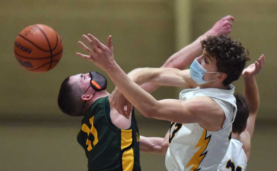 Glenbrook South's Nick Martinelli, right, blocks a shot by Glenbrook North's Ryan Cohen during Tuesday's game in Glenview.