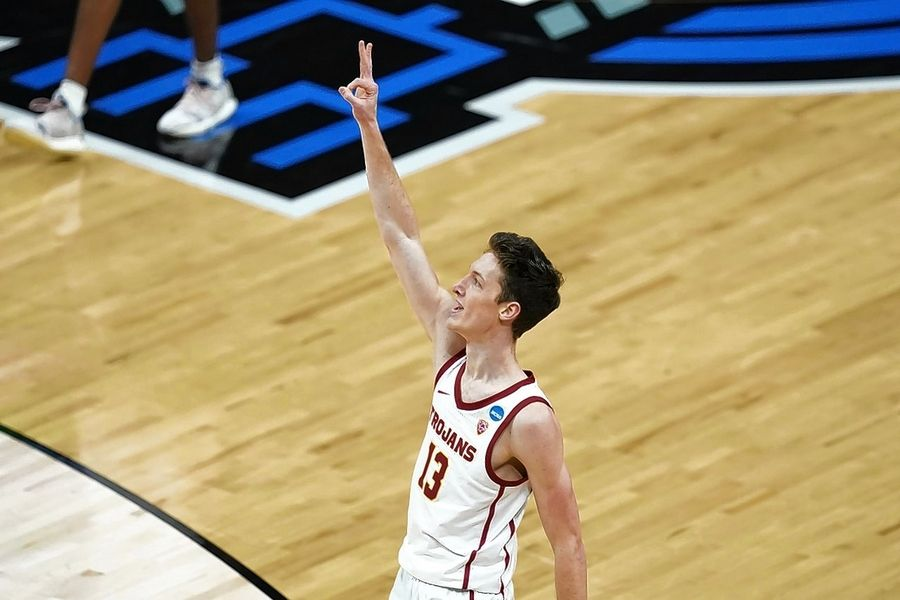 USC guard Drew Peterson, a former Libertyville standout, celebrates after making a 3-point basket during the second half of a Sweet 16 game against Oregon in the NCAA tournament at Bankers Life Fieldhouse on March 28 in Indianapolis.