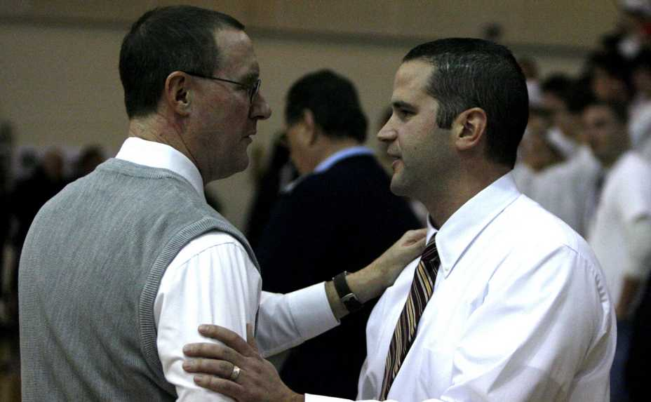 Former Conant boys basketball coach Tom McCormack, left, and former Schaumburg coach Matt Walsh reunite for a moment before the two teams played Thursday at Schaumburg in 2009. Walsh was named the new head coach Conant on Thursday.